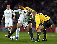Photo: Chris Ratcliffe.<br />Real Madrid v Arsenal. UEFA Champions League. 2nd Round, 1st Leg. 21/02/2006.<br />Ronaldo of Real Madrid tussles with Gilberto and Phillippe Senderos  of Arsenal.