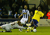 Fotball<br /> England 2005/2006<br /> Foto: SBI/Digitalsport<br /> NORWAY ONLY<br /> <br /> Colchester United v Cardiff City. Carling Cup.<br /> 24/08/2005.<br /> Cameron Jerome of Cardiff rounds keeper Dean Gerken before scoring the 2nd goal