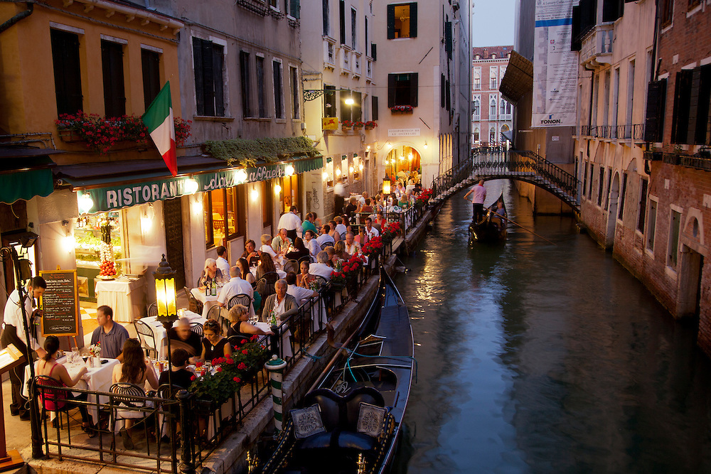 Europe, Italy, Venice, gondolas bridge and restaurant on small canal