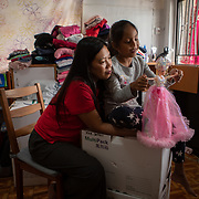 Vanessa Mae Rodel, 42, cuddles her seven-year-old daughter Keana Nihinsa, as they pack up  their home in Hong Kong, on March 21, 2019, ahead of their move to Canada. / Photo: Maria de la Guardia