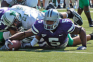Kansas State running back Thomas Clayton (5) stretches the ball over the goal line for a touchdown in the first quarter against Marshall, at Bill Snyder Family Stadium in Manhattan, Kansas, September 16, 2006.  The Wildcats beat the Thundering Herd 23-7.