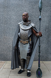© Licensed to London News Pictures. 24/05/2015. London, UK. A man dressed as Teal'C from Stargate SG-1 poses, as fans of anime, comic books, video games and more gather in large numbers at the Excel Centre to attend the bi-annual MCM Comic Con. Photo credit : Stephen Chung/LNP