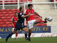 Photo: Lee Earle.<br /> Swindon v Southend. Coca Cola League 1.<br /> 10/09/2005. Swindon's Gareth Whalley (R) holds off Luke Guttridge.