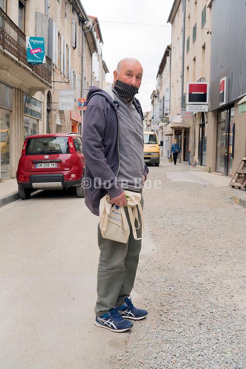 food shopper waiting outside portrait during Covid 19 crisis France Limoux April 2020