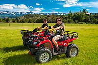 Teenagers riding all terrain vehicle, RIdgway, Colorado USA