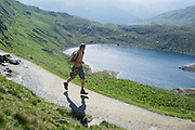 © Licensed to London News Pictures. 17/05/2014. Capel Curig, UK. A man runs up the PYG track. Walkers climb Snowdon in warm sunshine in North Wales today 17th May 2014. Photo credit : Stephen Simpson/LNP