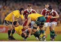29 June 2013; George North, British & Irish Lions, with Israel Folau and Rob Simmons, right, Australia. British & Irish Lions Tour 2013, 2nd Test, Australia v British & Irish Lions. Ethiad Stadium, Docklands, Melbourne, Australia. Picture credit: Stephen McCarthy / SPORTSFILE
