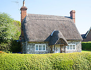 Pretty detached thatch and flint cottage Wilcot village, Wiltshire, England