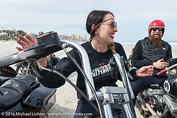 """Kissa Von Addams (R) of the """"Iron Lillies"""" and Jim Root from the band Slipknot on the beach during Daytona Bike Week 75th Anniversary event. FL, USA. Thursday March 3, 2016.  Photography ©2016 Michael Lichter."""