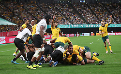 Australia's Silatolu Latu scores their fourth try during the 2019 Rugby World Cup Pool D match at Sapporo Dome.