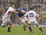 Twickenham, Surrey, 15th February 2003, Six Nationals International RFU Stadium, England,[Mandatory Credit: Peter Spurrier/Intersport Images], <br /> RBS - Six Twickenham, Surrey, 15th February 2003, Six Nationals International RFU Stadium, England,[Mandatory Credit: Peter Spurrier/Intersport Images],  Rugby England v France<br /> French full back Clement Pointrenaud, looks for the gap between Steve Thompson left and Jason Robinson.