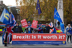 London, UK. 21st November, 2018. Anti-Brexit activists from SODEM (Stand of Defiance European Movement) protest opposite Parliament on the day on which Prime Minister Theresa May is scheduled to travel to Brussels to attend discussions with Jean-Claude Juncker, President of the European Commission, regarding a political declaration to accompany the withdrawal agreement.
