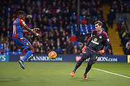 Goalkeeper Costel Pantilimon of Sunderland is under pressure by Wilfried Zaha of Crystal Palace (l). Barclays Premier league match, Crystal Palace v Sunderland at Selhurst Park in London on Monday 23rd November 2015.<br /> pic by John Patrick Fletcher, Andrew Orchard sports photography.