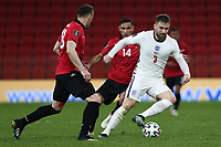 TIRANA, ALBANIA - MARCH 28: Luke Shaw of England is closed down by Qazim Laci of Albania during the FIFA World Cup 2022 Qatar qualifying match between Albania and England at the Qemal Stafa Stadium on March 28, 2021 in Tirana, Albania. Sporting stadiums around Europe remain under strict restrictions due to the Coronavirus Pandemic as Government social distancing laws prohibit fans inside venues resulting in games being played behind closed doors (Photo by MB Media)