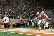 AUSTIN, TX - AUGUST 31:  John Harris #9 of the University of Texas Longhorns celebrates with quarterback David Ash after catching a 54 yard touchdown pass against the New Mexico State Aggies on August 31, 2013 at Darrell K Royal-Texas Memorial Stadium in Austin, Texas.  (Photo by Cooper Neill/Getty Images) *** Local Caption *** John Harris; David Ash