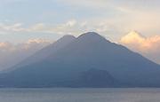Early morning view across Lake Atitlan from Panajachel of  Volcan Toliman, 3153m, and, behind it,  Volcan Atltlan, 3525m. The hill in front is Cerro de Oro. Panajachel, Republic of Guatemala. 04Mar14.