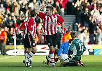 Photograph: Scott Heavey.<br />Southampton v Portsmouth. FA Barclaycard Premiership. 21/12/2003.<br />James Beattie celebrates making it 3-0