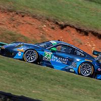 Alton, VA - Aug 26, 2016:  The Team Seattle Alex Job Racing Porsche races through the turns at the Michelin GT Challenge at VIR at Virginia International Raceway in Alton, VA.