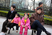 Retirees and kids siting on a bench at a park in Shanghai, China on 15 March, 2009. According to a recent census, with a low birth rate and increase greying of society, Shanghai's native population, not counting immigrants, has declined steadily for the last 17 years, with natural population growth at -.75% last year.