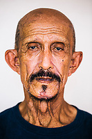 A portrait of Bob Velez, a 76-year-old Filipino man from the town of Cutud who has been nailing himself to a cross every Good Friday since 1979.