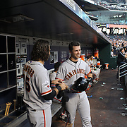 Brandon Crawford, (left) and Buster Posey, San Francisco Giants, in the dugout preparing to bat during the New York Mets Vs San Francisco Giants MLB regular season baseball game at Citi Field, Queens, New York. USA. 11th June 2015. Photo Tim Clayton