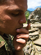 """A Colombian soldier shows off how the """"98"""" butterfly likes to tickle his nose - Ciudad Perdida - Colombia"""
