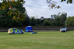 © Licensed to London News Pictures. 13/10/2021. London, UK. A police forensic tent and police car on Craneford Way Playing Fields following the fatal stabbing of a teenager. Police were called at 16:45BST on Tuesday, 12 October to reports of a stabbing in Craneford Way, Twickenham. Metropolitan Police Service (MPS) and London Ambulance Service (LAS) attended. They found an 18-year-old man who is believed to have sustained knife wounds. He was taken by LAS to an outer London hospital where he was pronounced dead at 17:54BST. Photo credit: Peter Manning/LNP