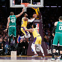 LOS ANGELES, CA - MAR 09: LeBron James (23) of the Los Angeles Lakers goes for the reverse layup past Al Horford (42) of the Boston Celtics during a game on March 09, 2019 at the Staples Center, in Los Angeles, California.