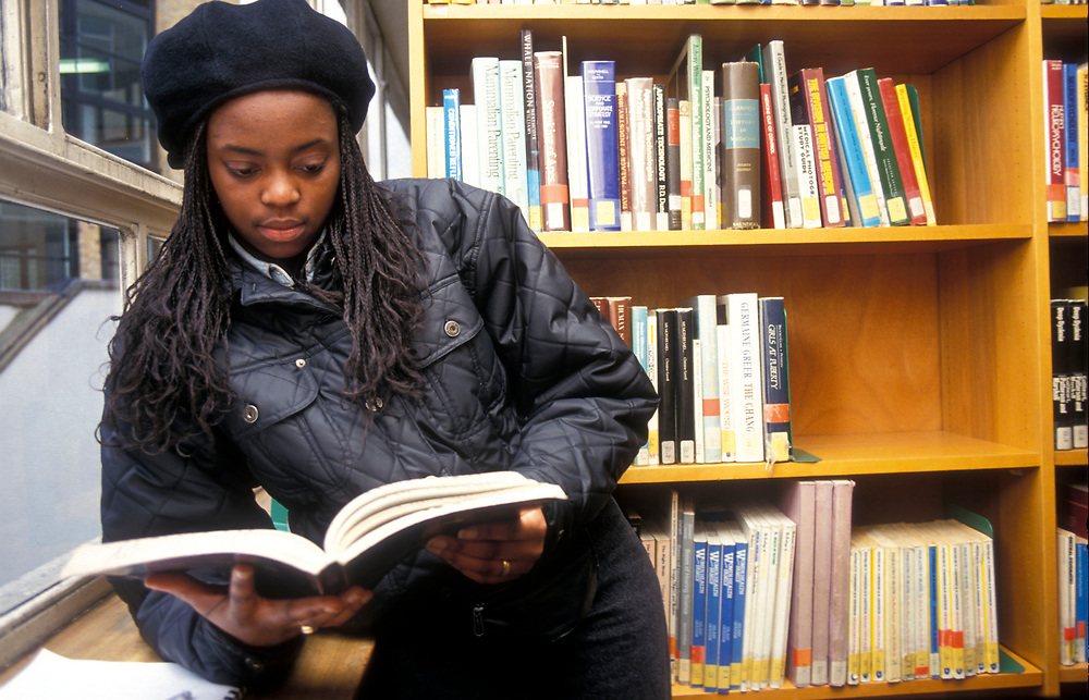 Young black woman researcing in the university library,