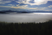 Overlooking the Purcell Mountains and fogbank at sunrise. Yaak Valley, northwest Montana.