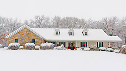 Snow falls in winter 2013 on this lovely home in New Melle, Missouri