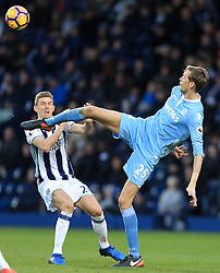 4 February 2017 - Premier League - West Bromwich Albion v Stoke City - Peter Crouch of Stoke City puts a boot in the face of Darren Fletcher of West Bromwich Albion - Photo: Paul Roberts / Offside
