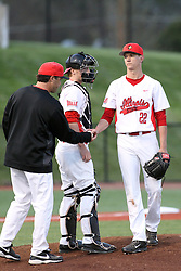 21 April 2015:  Danny Jackson looks on as Matt Lambert hands the ball to Bo Durkac and leaves the mound during an NCAA Inter-Division Baseball game between the Illinois Wesleyan Titans and the Illinois State Redbirds in Duffy Bass Field, Normal IL