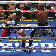 LAS VEGAS, NV - SEPTEMBER 13: Floyd Mayweather Jr. (R) throws a punch over Marcos Maidana during their WBC/WBA welterweight title fight at the MGM Grand Garden Arena on September 13, 2014 in Las Vegas, Nevada. (Photo by Alex Menendez/Getty Images) *** Local Caption *** Floyd Mayweather Jr; Marcos Maidana