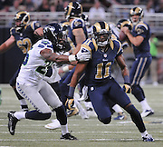 Football - NFL- Seattle Seahawks at St. Louis Rams.Seattle Seahawks cornerback Richard Sherman (25) keeps pace with St. Louis Rams wide receiver Brandon Gibson (11) who runs a pattern for a pass in the second quarter at the Edward Jones Dome in St. Louis.  The Rams defeated the Seahawks, 19-13.  In the background, at right, is St. Louis Rams quarterback Sam Bradford (8).
