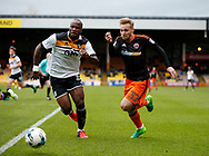 Andre Bikey of Port Vale tussles with Harry Chapman of Sheffield Utd during the English League One match at Vale Park Stadium, Port Vale. Picture date: April 14th 2017. Pic credit should read: Simon Bellis/Sportimage