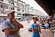 Oct. 6, 2009 -- SAMUT SAKHON, THAILAND: Burmese workers take a break from their job in a shrimp processing plant, which is across the street from their tenement in Samut Sakhon, Thailand, Oct. 6. The Thai fishing industry is heavily reliant on Burmese and Cambodian migrants. Burmese migrants crew many of the fishing boats that sail out of Samut Sakhon and staff many of the fish processing plants in Samut Sakhon, about 45 miles south of Bangkok. Migrants pay as much $700 (US) each to be smuggled from the Burmese border to Samut Sakhon for jobs that pay less than $5.00 (US) per day.   Photo by Jack Kurtz / ZUMA Press