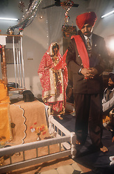 Bride and groom at wedding ceremony in Patiala; Punjab; India,