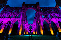 © Licensed to London News Pictures. 27/09/2018. Rievaulx UK. The stunning ruins of Rievaulx Abbey in North Yorkshire have been illuminated for the first time, the abbey will be bathed in light for three nights over this weekend allowing visitors to experience the historic site like never before. With light, sound and the beautiful surroundings the event will connect visitors with the magic and awe experienced by monks and visitors alike when the abbey was at the height of its wealth and power. The Abbey will be illuminated from the 28th September until 30th September. Photo credit: Andrew McCaren/LNP