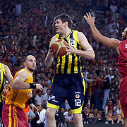 Galatasaray's Ermal KURTOGLU (2ndL),and Fenerbahce's Oguz SAVAS (L), Darjus LAVRINOVIC (2ndR) during their Turkish Basketball league Play Off Final fourth leg match Galatasaray between Fenerbahce Ulker at the Abdi Ipekci Arena in Istanbul Turkey on Saturday 11 June 2011. Photo by TURKPIX