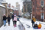 Local residents enjoy the first snowfall of winter on 24th January 2021 in Windsor, United Kingdom. The current spell of cold weather is expected to continue for another two or three days.