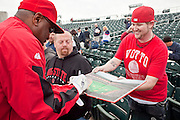 27 FEBUARY 2010 -- GOODYEAR, AZ: Dusty Baker (LEFT) autographs a book for Jordan Lee (CQ) from Los Angeles, CA, at the new ballpark in Goodyear Saturday.  PHOTO BY JACK KURTZ