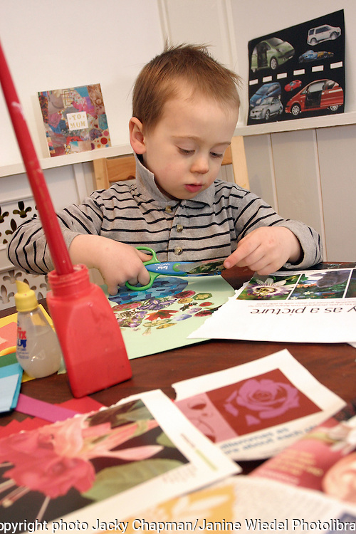 Young child cutting and pasting handmade card