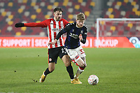 Middlesbrough's Hayden Coulson and Brentford's Halil Dervisoglu<br /> <br /> Photographer Rob Newell/CameraSport<br /> <br /> The Emirates FA Cup Third Round - Brentford v Middlesbrough - Saturday 9th January 2021 - Brentford Community Stadium - Brentford<br />  <br /> World Copyright © 2021 CameraSport. All rights reserved. 43 Linden Ave. Countesthorpe. Leicester. England. LE8 5PG - Tel: +44 (0) 116 277 4147 - admin@camerasport.com - www.camerasport.com