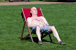 © Licensed to London News Pictures. 18/04/2018. London, UK. A man sunbathes during hot weather in St James's Park, London. Photo credit: Rob Pinney/LNP