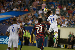 July 19, 2017 - Philadelphia, Pennsylvania, U.S - United States of America midfielder GYASI ZARDES (9) fights for a header with El Salvador defender BRYAN TAMACAS (21) while United States of America forward JOZY ALTIDORE (27) and El Salvador defender HENRY ROMERO (4) looks on during CONCACAF Gold Cup 2017 quarterfinal action at Lincoln Financial Field in Philadelphia, PA.  USA  defeats El Salvador 2 to 0. (Credit Image: © Mark Smith via ZUMA Wire)