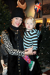 ALICE TEMPERLEY and her son FOX at the Juicy Couture children's tea party in aid of Mothers 4 Children held at the Juicy Couture Store, Bruton Street, London on2nd December 2009.