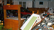 6/8/08 Omaha, NEStorm damage from a possible  tornado..House of Allen Krabbenhoft of 5071 134th steet.  His garage blew off its foundation leaving his two cars intact and in place..(chris machian/Omaha World Herald)