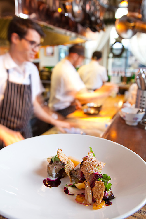 Le Pigeon - Lemon Grass rubbed Pigeon grilled and served with quinoa & Lime & Golden Beet Salad, Cumquat and Quinoa  Cracker w/ yogurt and beet juice. Line cookers, Andrew Mace, Tome Hill and Christopher Neal in the background.