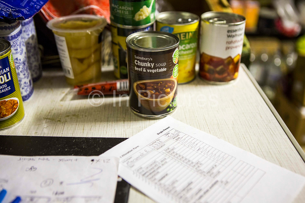 Tinned can Sainsbury's chunky soup beef and vegetable placed on a table with other non-perishable food in the Trussell Trust Kingston foodbank, England, United Kingdom.  The food has been donated to the foodbank through schools, churches and individuals.  In 2012-13 foodbanks fed 346,992 people nationwide. Of those helped, 126,889 were children.  In response to the Government cuts to welfare, foodbanks have experienced a significant increase in demand and in September 2013, Kingston foodbank provided food for their 5,000th person.  The emergency food supplies are organised by volunteers who use a checklist to prepare each food-box.